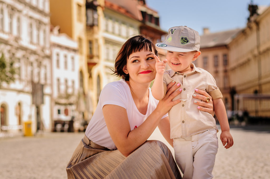 Young mother with little boy in the center of the Prague